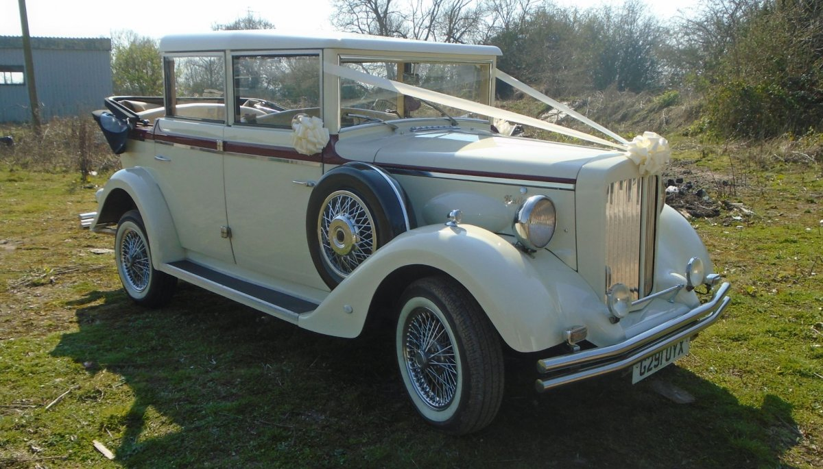 vintage ivory wedding car with roof down
