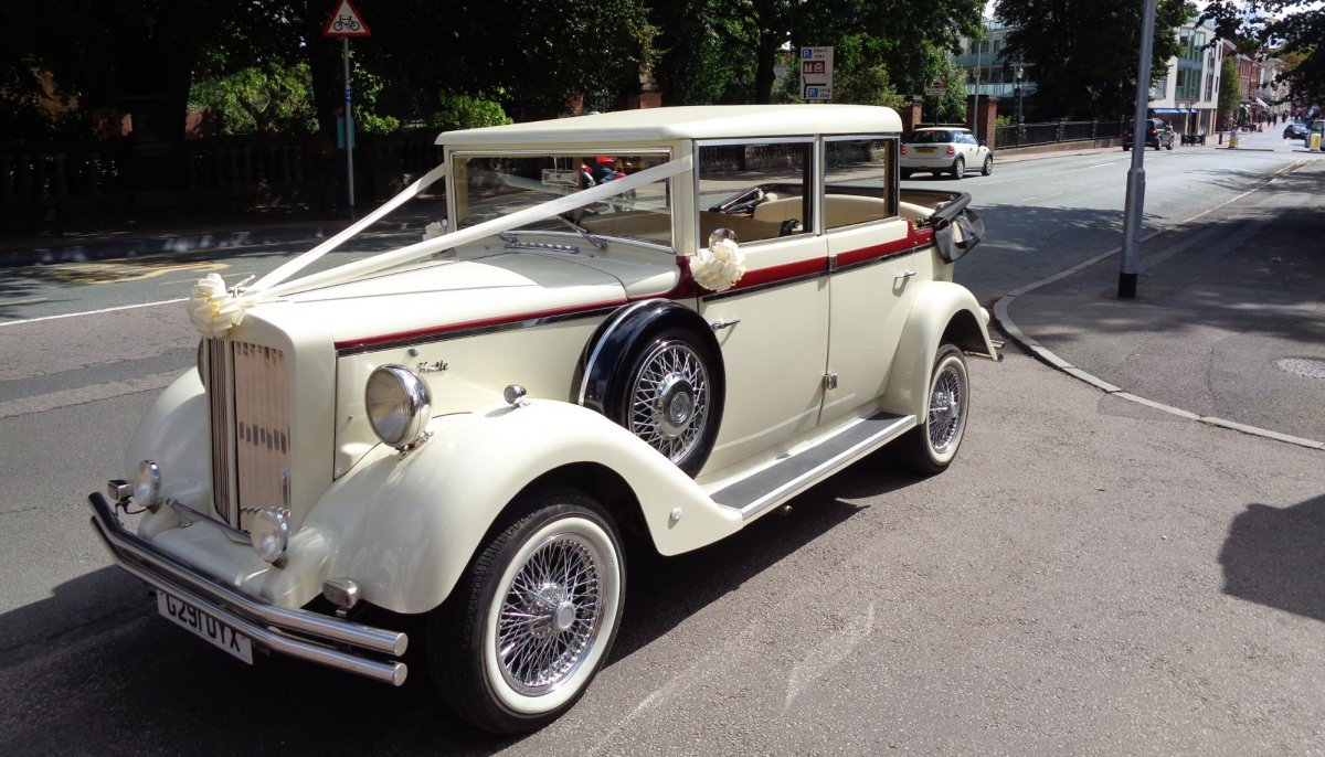 ivory vintage Style Regent Landaulet wedding car parked in Lichfield with it's roof down