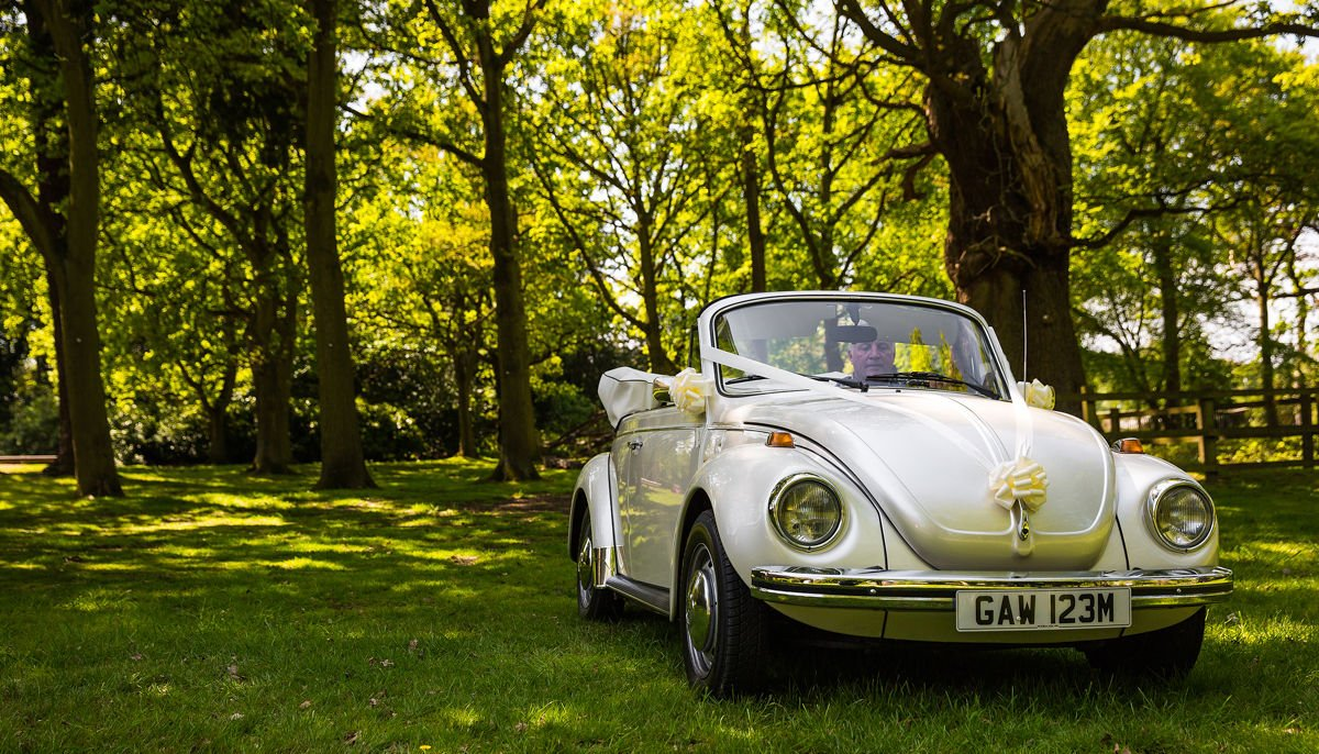 Front view of ivory vintage VW Beetle cabriolet with roof down, parked in the grounds of Drayton Manor Hotel