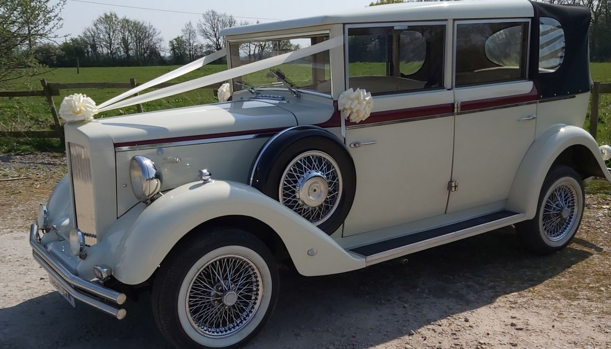 Ivory vintage style wedding car with ivory ribbons